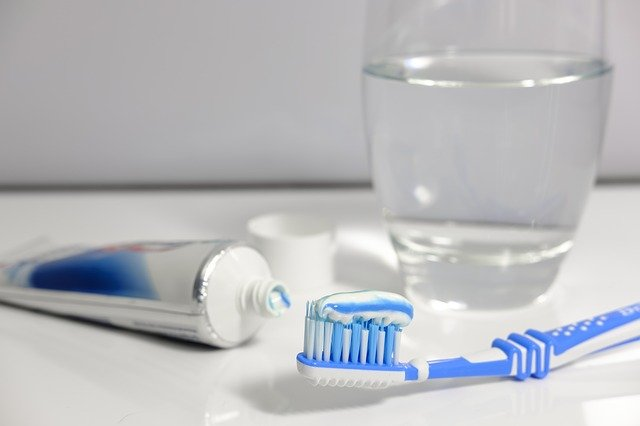 What does fluoride do in protecting your teeth?